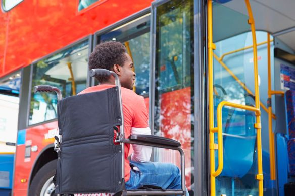 Man in wheelchair getting into a bus