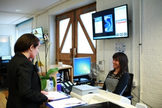 Visitor arriving at reception of an office