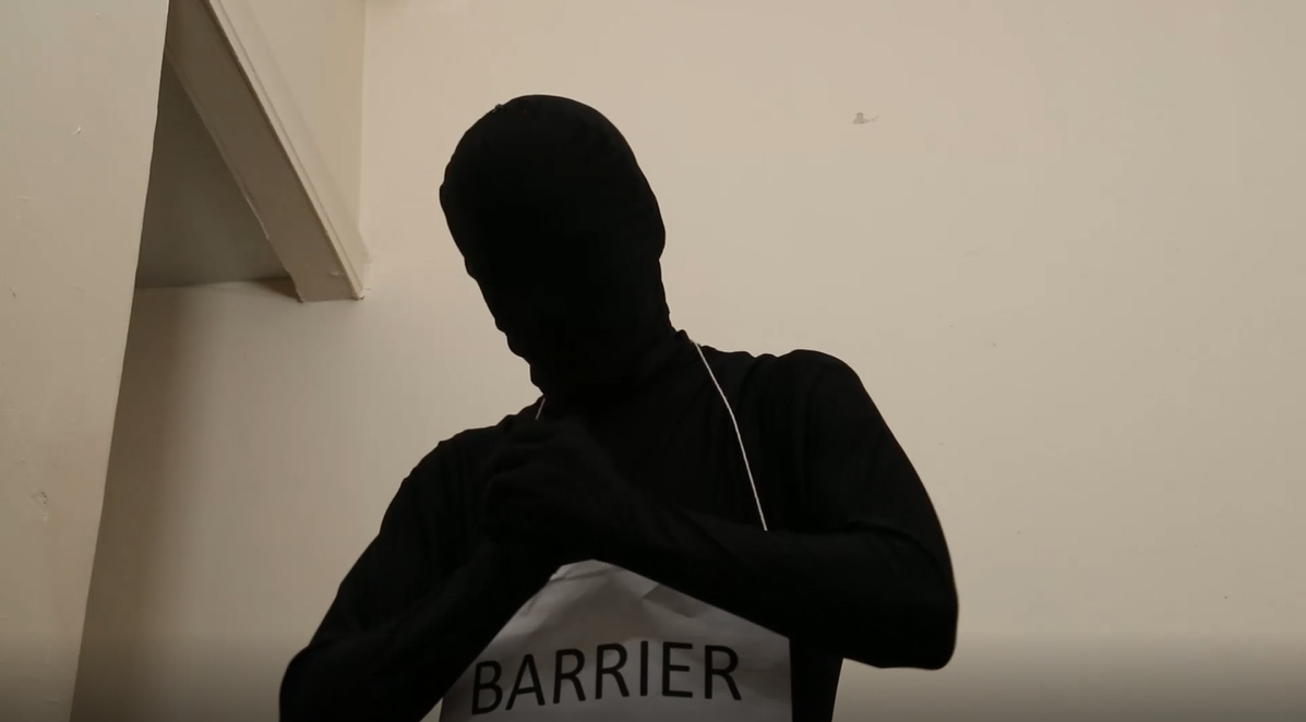 Barrier in human form covered in black