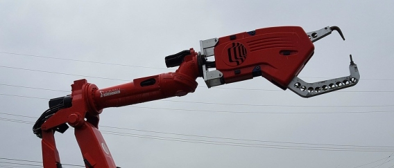 Robotic arm with power lines in background