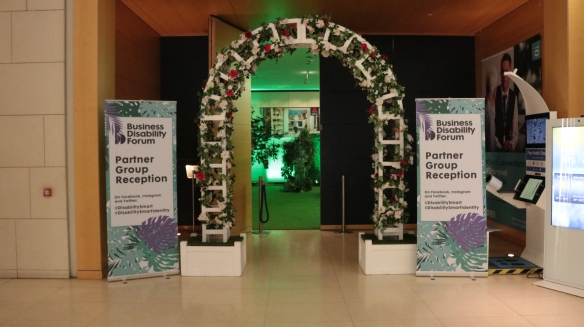 Floral archway entrance to the Partner Group Reception