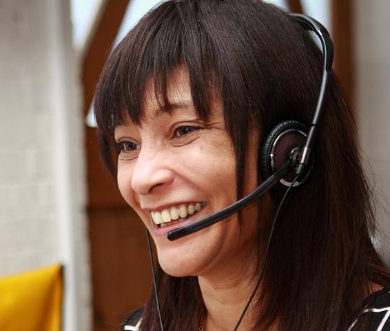 Katherine Beavis wearing a headset