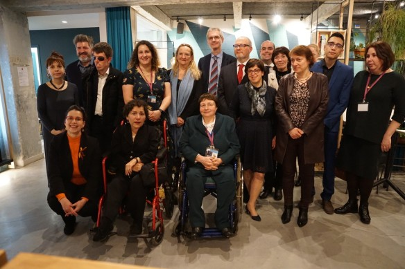 group photo of all European and Canadian attendees posing with organisers from the French Ministry of Justice