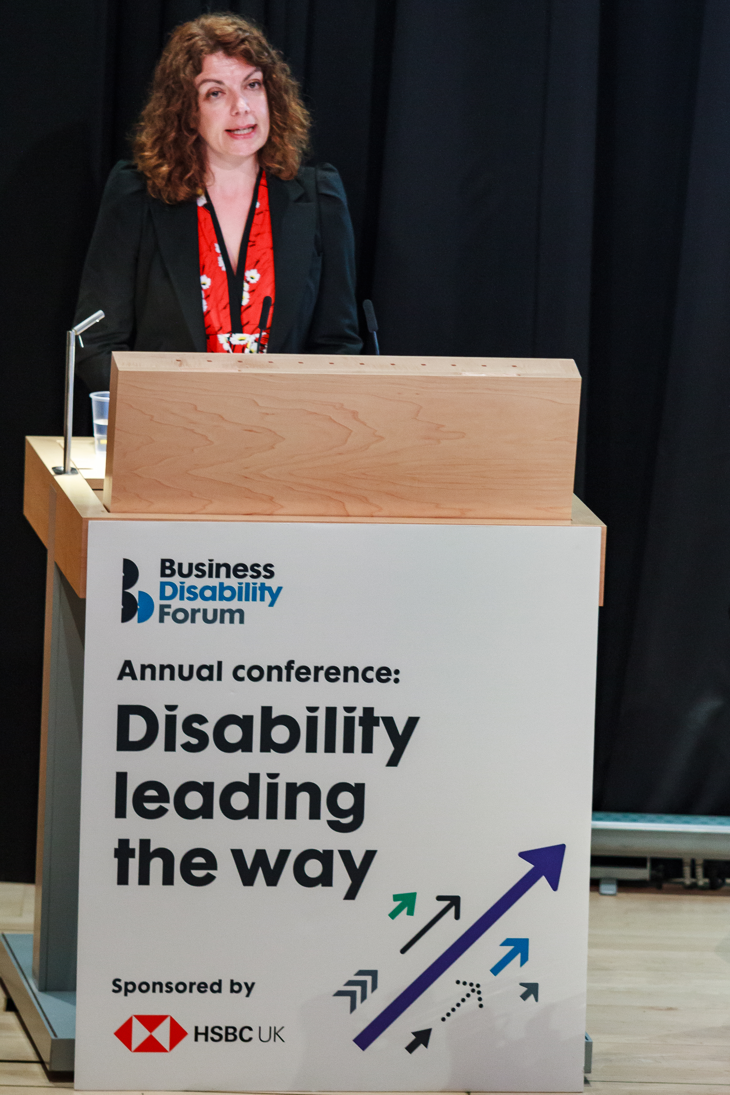 Diane Lightfoot, CEO of Business Disability Forum at the lectern of the annual conference Disability leading the way