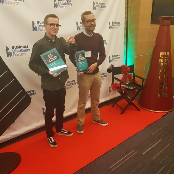 Winners Samuel Ash (left) and William Horsefield (right) holding their awards, There are film props behind them.