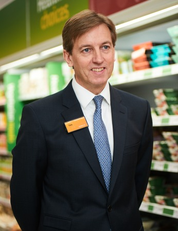 Tim Fallowfield, Company Secretary and Board Sponsor for Disabilities, Carers and Age in front of Sainsbury's groceries